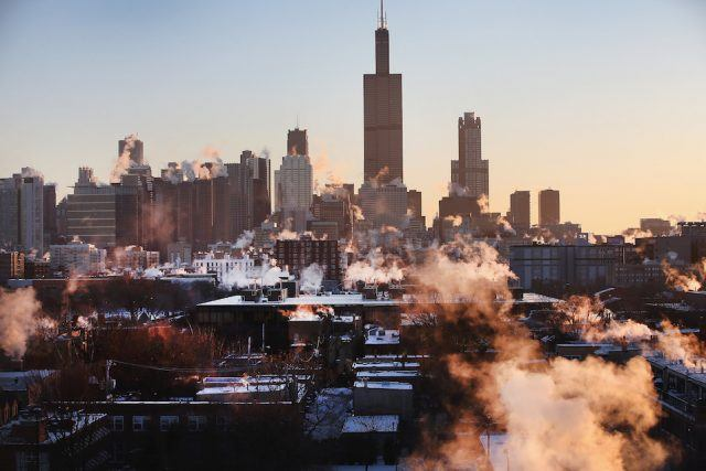 The sun rises behind the skyline as temperatures hovered around -10 degrees in Chicago, Illinois