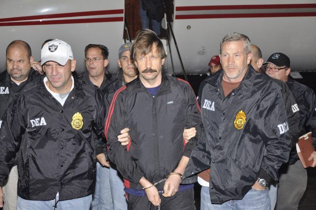 Former Soviet military officer and arms trafficking suspect Viktor Bout deplanes after arriving at Westchester County Airport