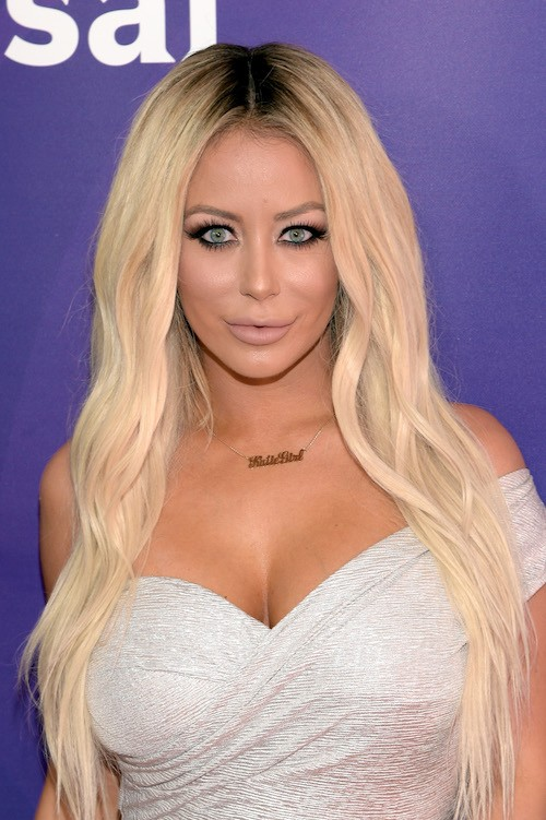 Aubrey O'day on a red carpet.
