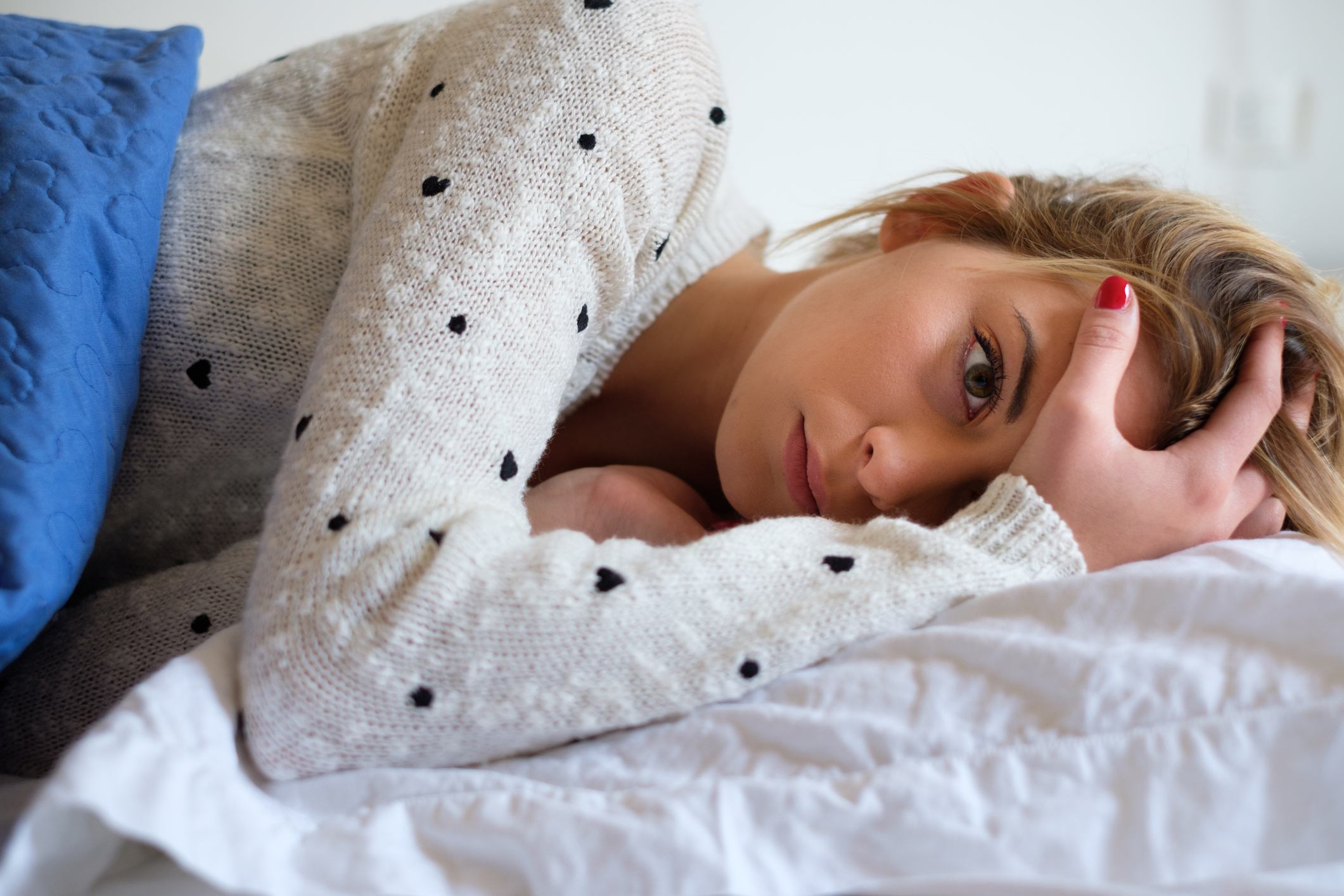 Young girl tired and lying on the bed