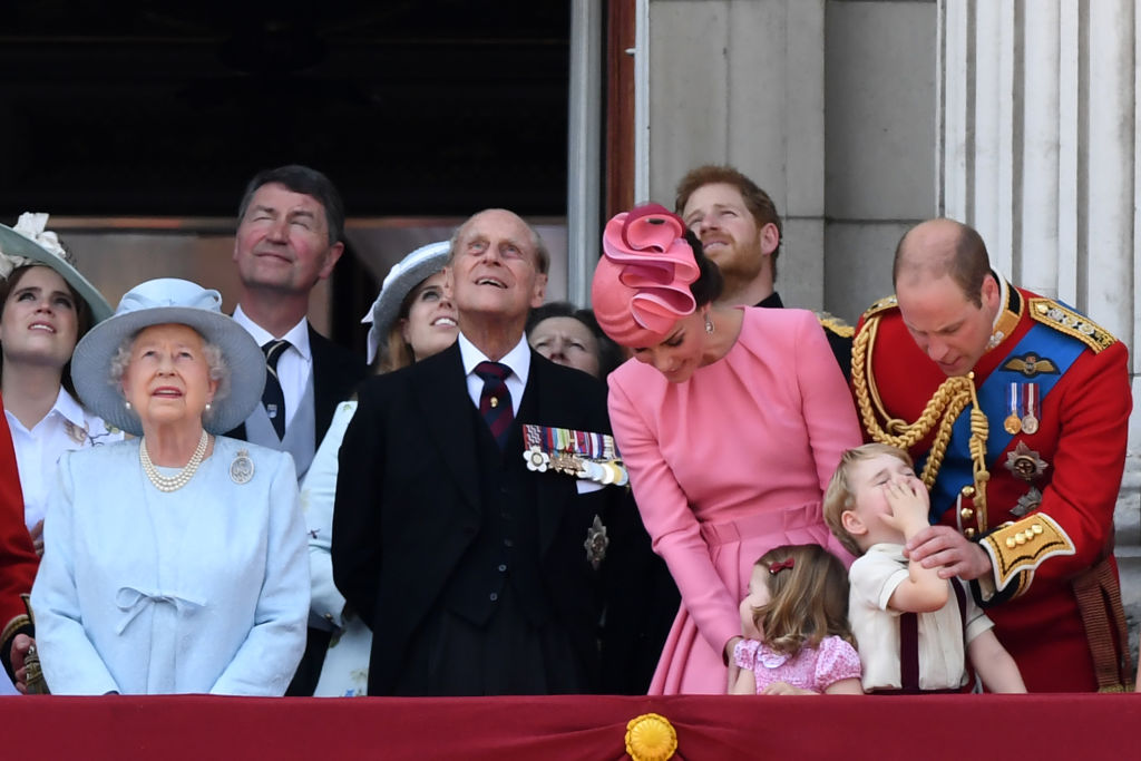 Britain's Prince Harry and Britain's Prince William, Duke of Cambridge, stand on the balcony of Buckingham Palace to watch a fly-past of aircraft by the Royal Air Force