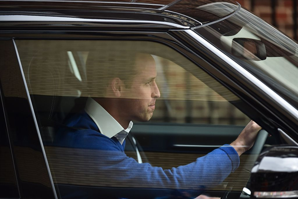 Britain's Prince William, Duke of Cambridge, drives himself away as he leaves the Lindo Wing at St Mary's Hospital