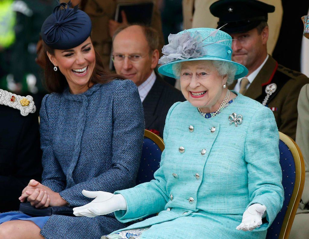 Britain's Catherine, Duchess of Cambridge laughs as Britain's Queen Elizabeth II gestures as they watch part of a children's sports event