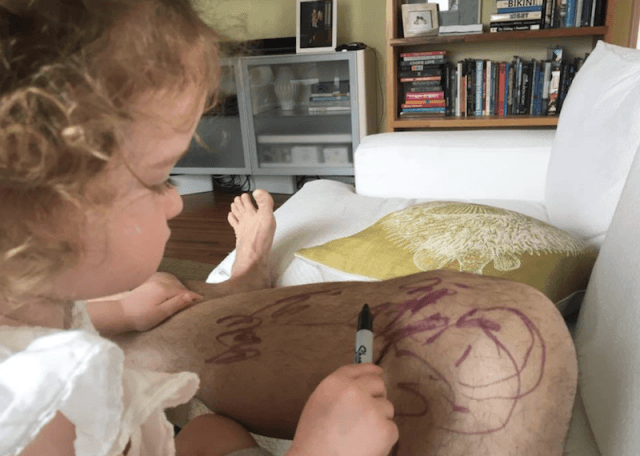 Jimmy Kimmel's daughter scribbling on his leg with a sharpie.