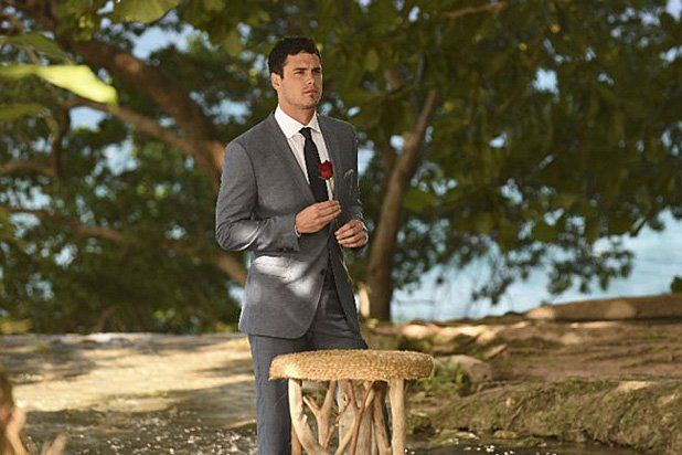 Ben Higgins holds a rose