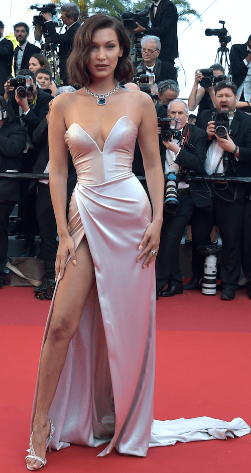 Bella Hadid posing on a red carpet at the Cannes Film Festival.