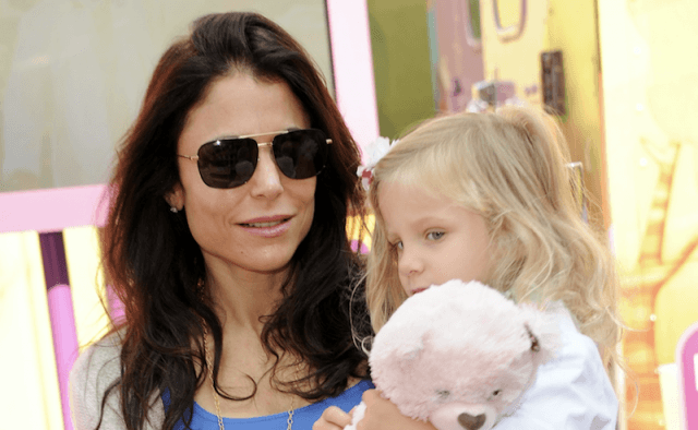 Bethenny Frankel holding her daughter.