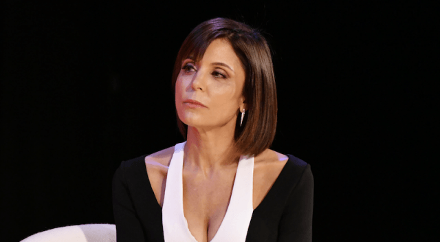 Bethenny Frankel looking sad while wearing a black and white dress.