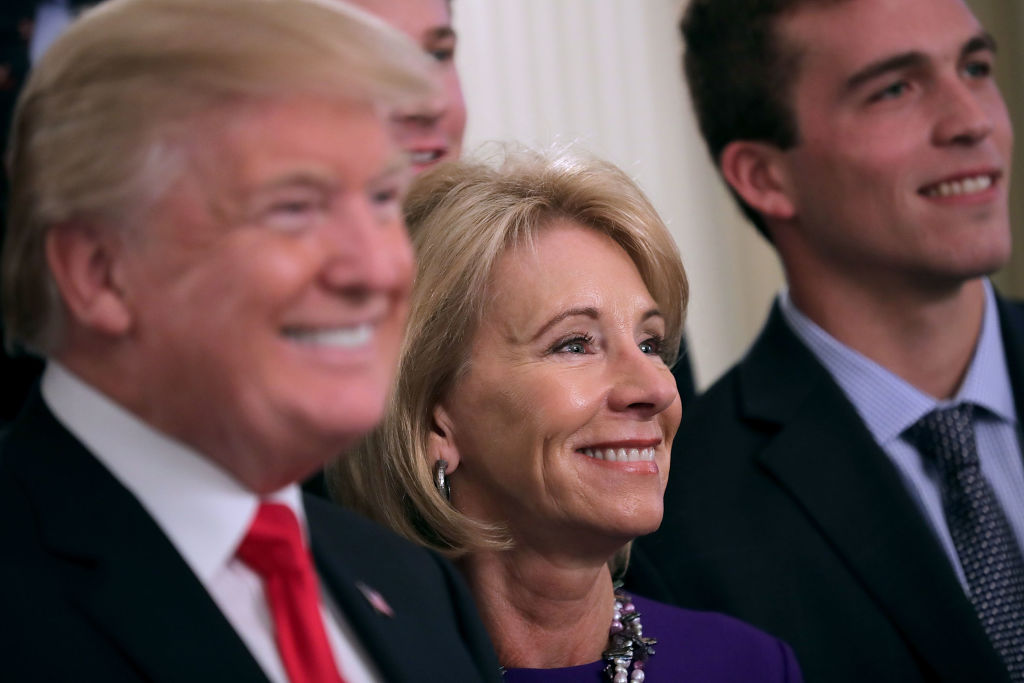 U.S. President Donald Trump and Education Secretary Betsy Devo