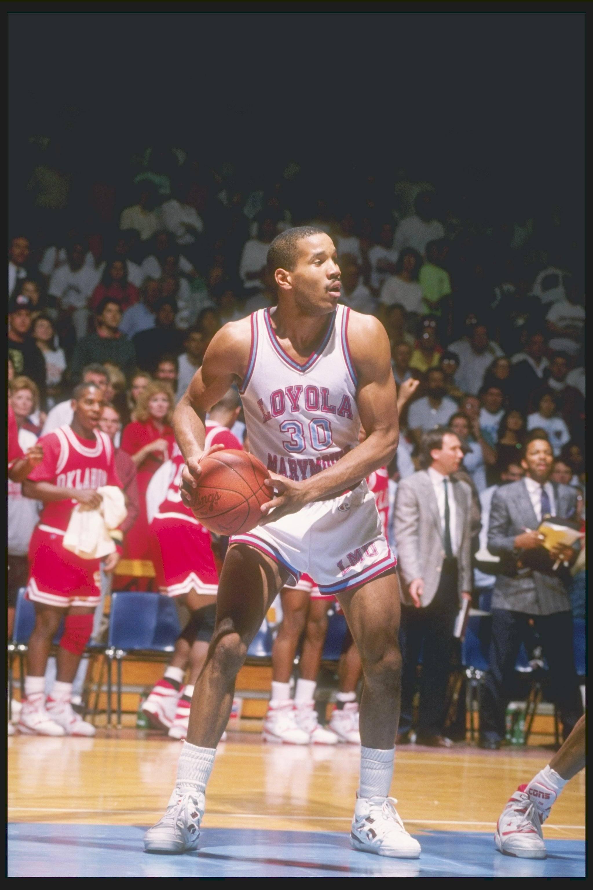 Bo Kimble of Loyola holds the ball
