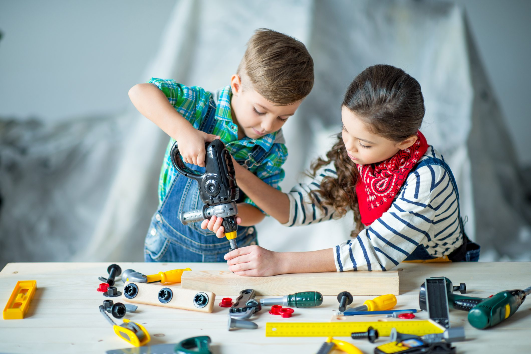 Boy and girl with toy tools