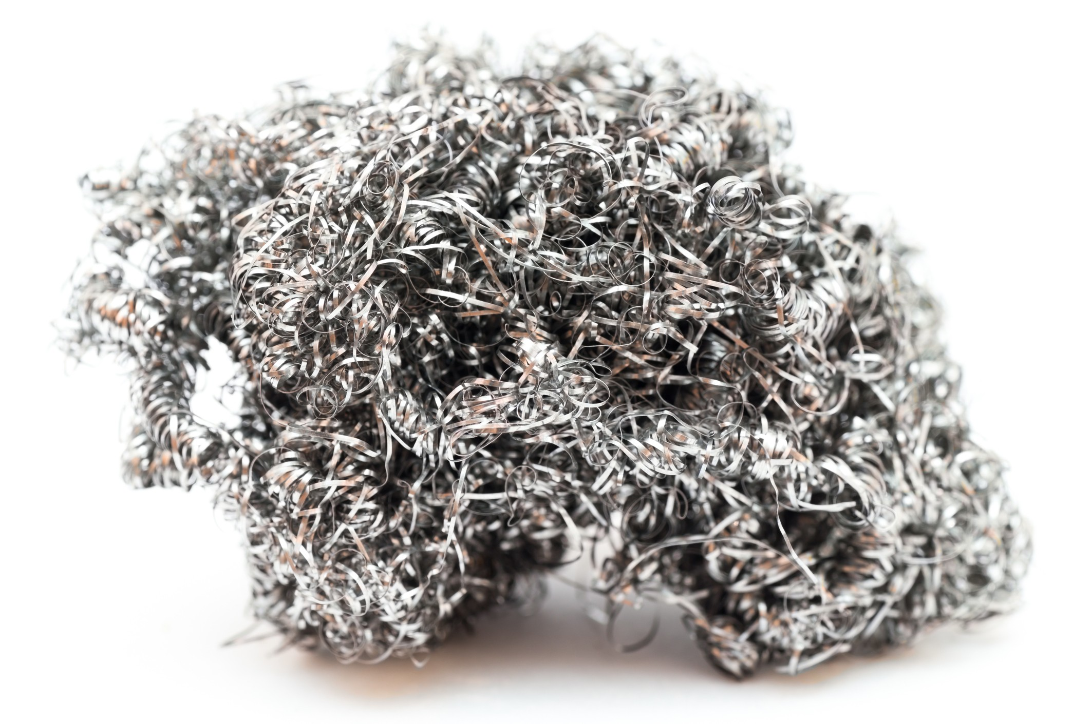 Brillo pad steel wool on white background.