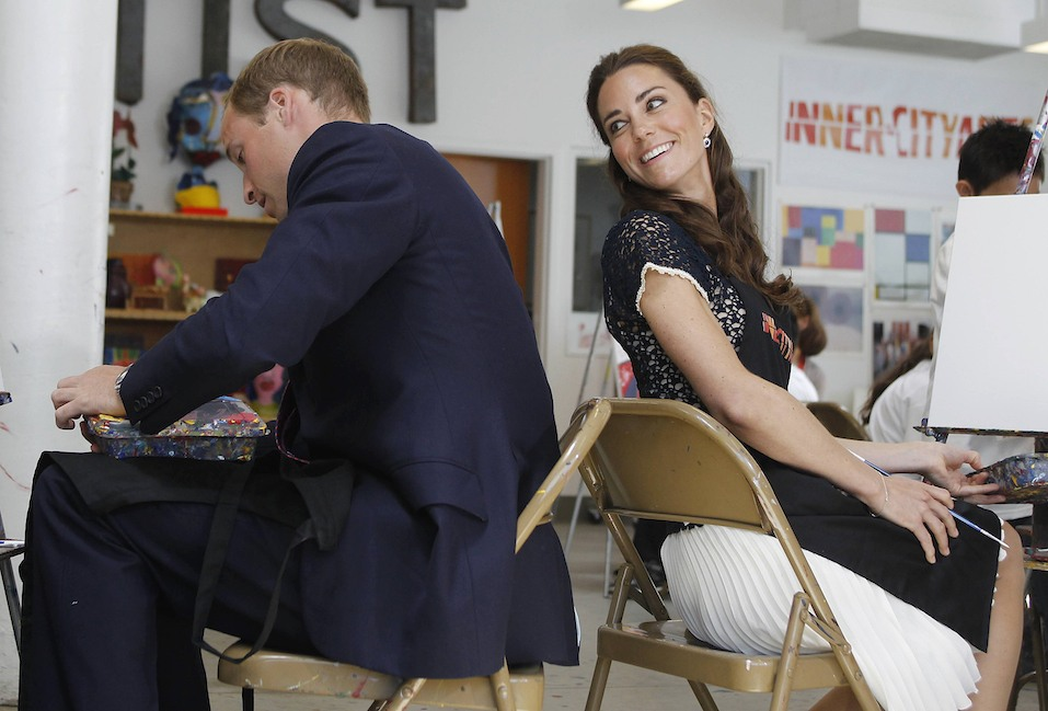 Britain's Prince William and his wife Catherine, Duchess of Cambridge, exchange conversation as they sit down to paint a picture