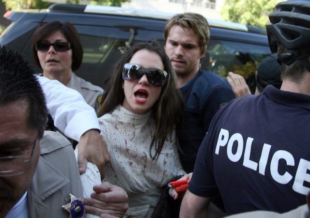 Britney Spears being mobbed by paparazzi.