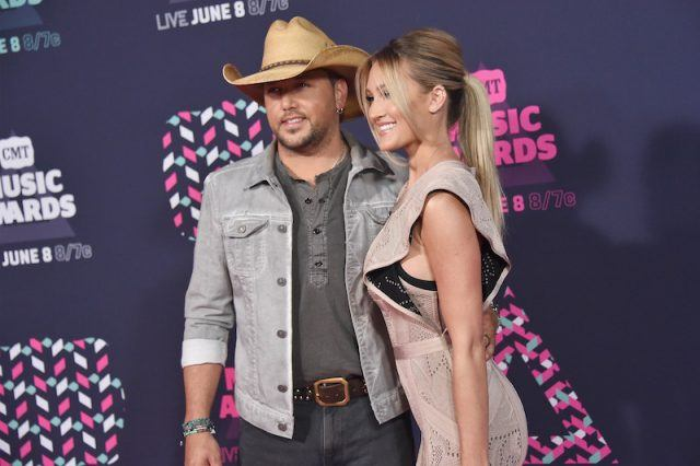 Jason and Brittany posing on a red carpet together.