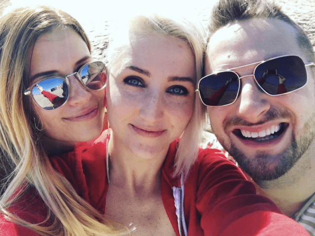 Adam, Brooke and Jane smiling in a selfie.