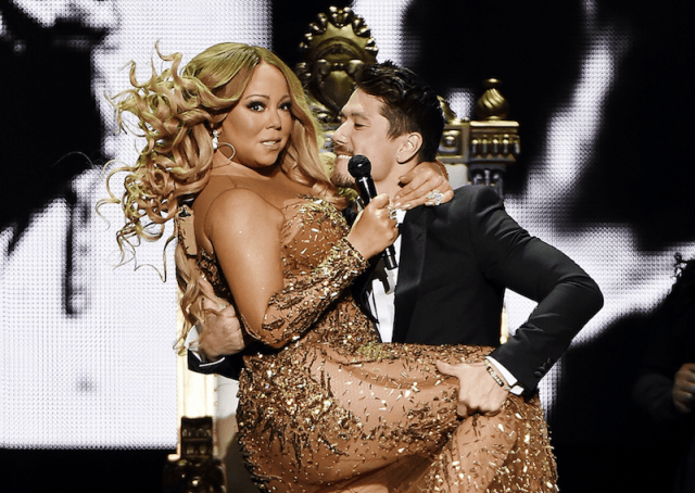 Mariah Carey on stage with one of her dancers.