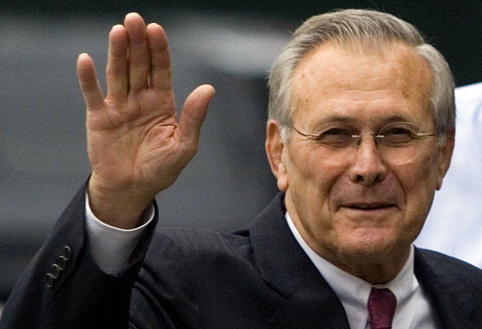 U.S. Secretary of Defense Donald Rumsfeld waves from outside the White House