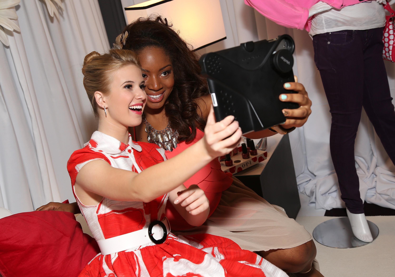 Actress Caroline Sunshine (L) and Radio Disney On-Air personality Hallie Ashford take a selfie