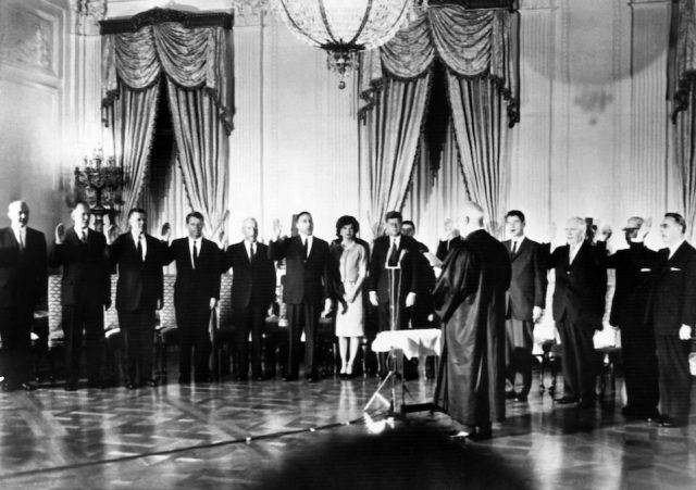 Members of the cabinet of US President John Fitzgerald Kennedy take the oath during the swearing-in of the new cabinet