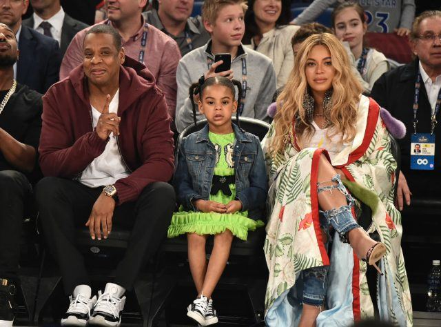 Jay Z, Blue Ivy Carter and Beyoncé Knowles attend the 66th NBA All-Star Game at Smoothie King Center