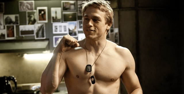 Raleigh Becket pumping his fist while shirtless.