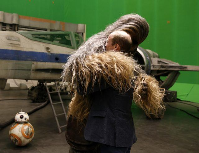Prince William hugging Chewbacca.