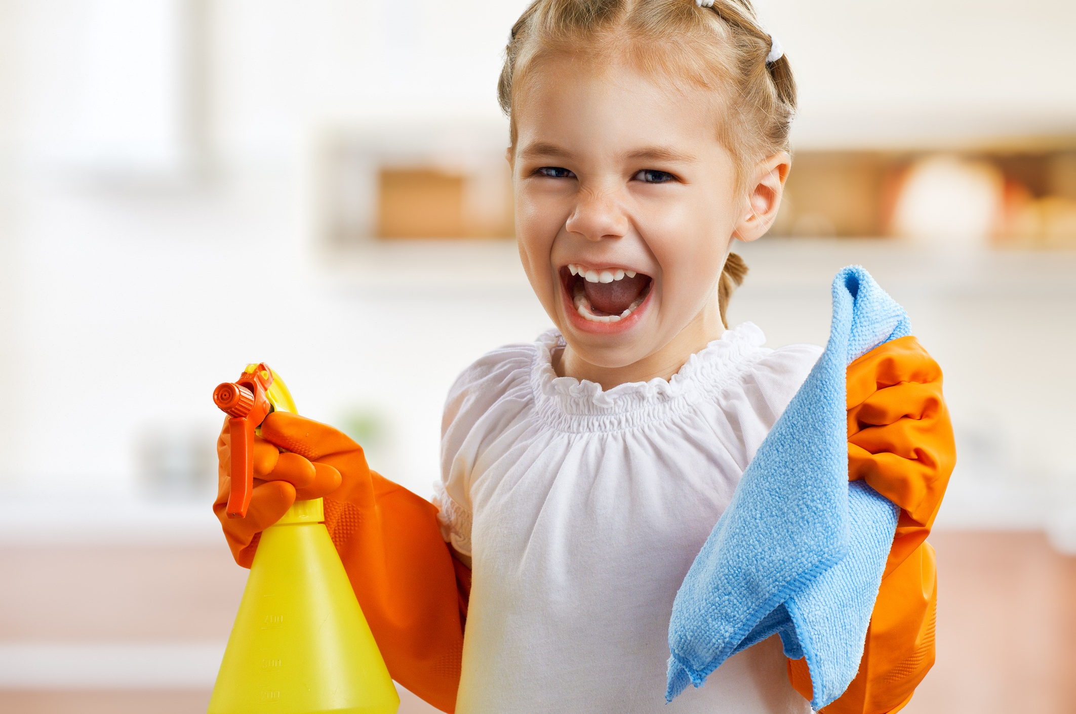 Little girl doing chores and cleaning