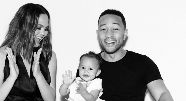 Chrissy Teigen, John Legend and Luna in a black and white photograph.