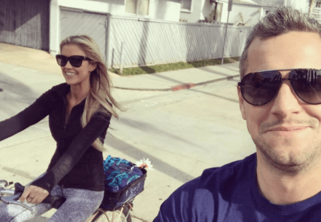 Christina El Moussa riding a bike with Anstead.