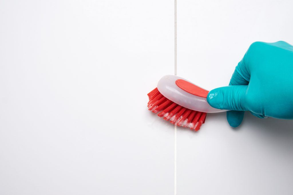 Cleaning shower or bathroom grout with a scrub brush