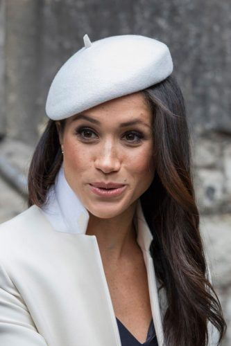 Meghan wearing a white beret.