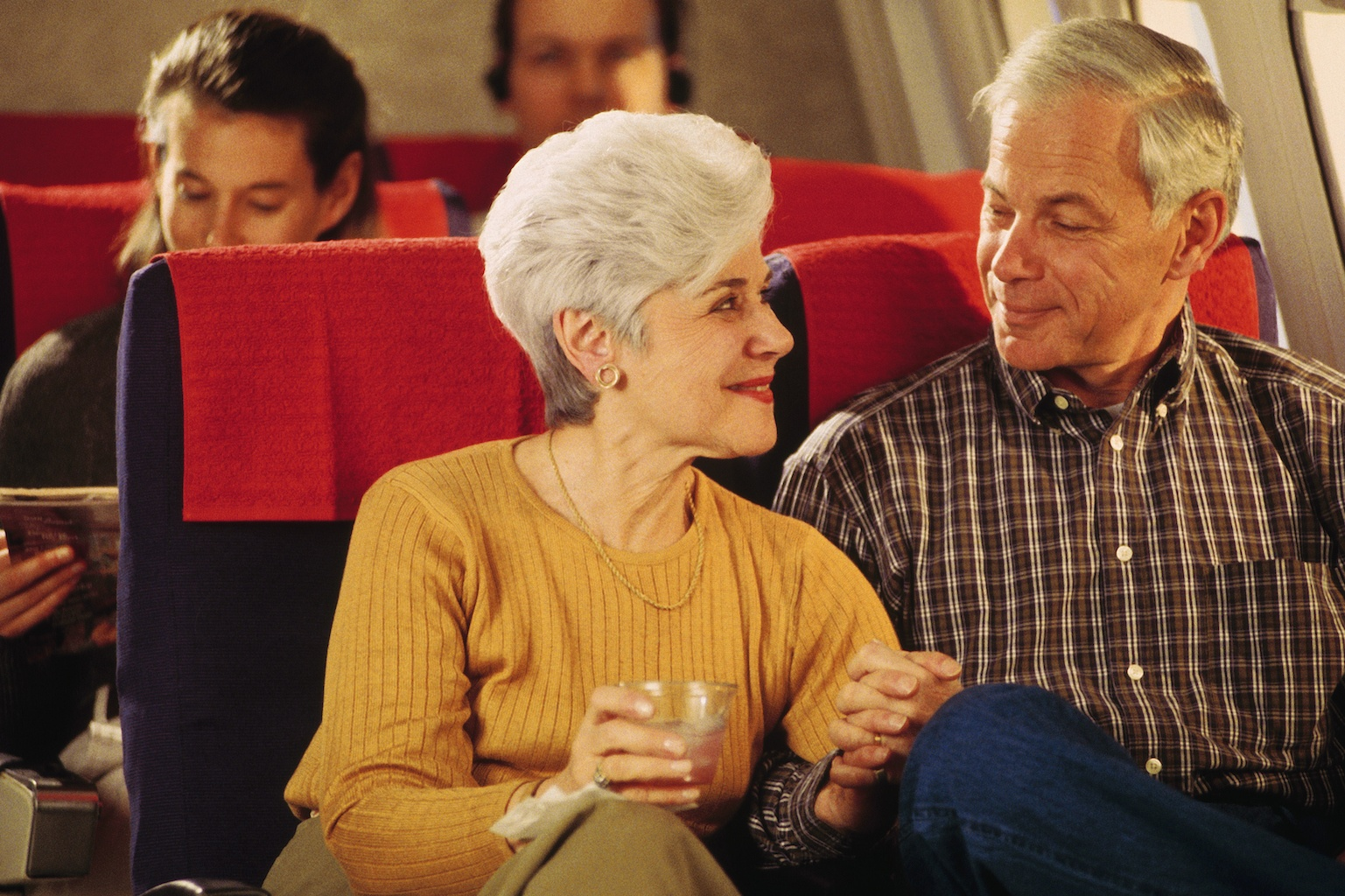 Senior Couple on airplane in the 1990s