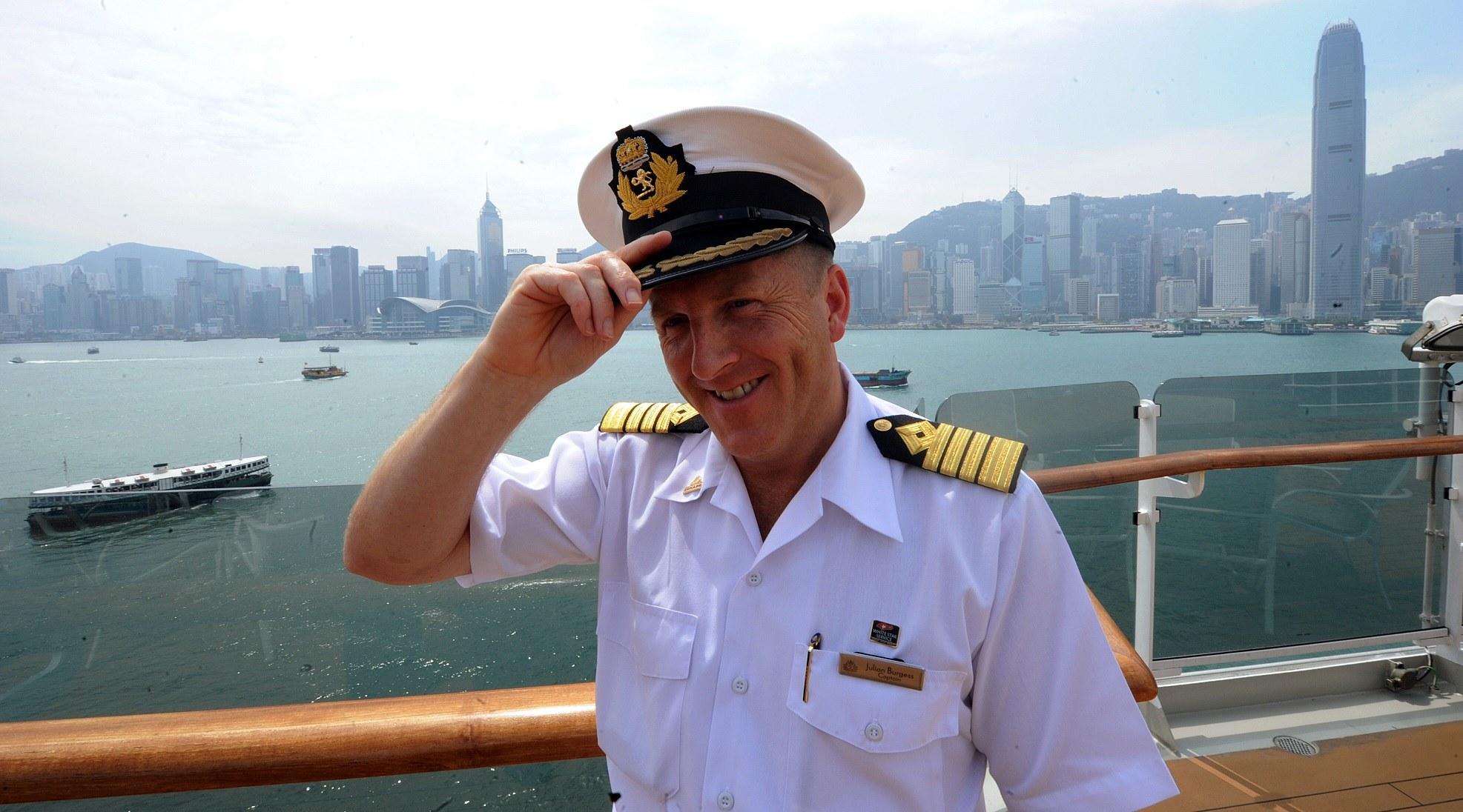 Captain Julian Burgess stands on board Queen Elizabeth cruise ship
