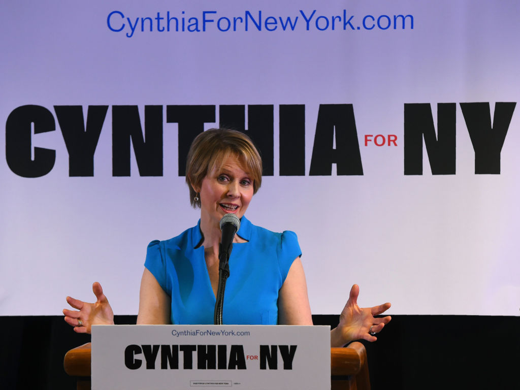 Cynthia Nixon speaking at a podium