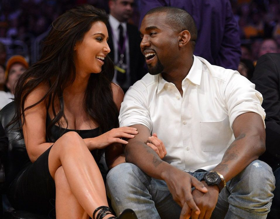 Kim Kardashian and rapper Kanye West talk from their courtside seats as the Los Angeles Lakers