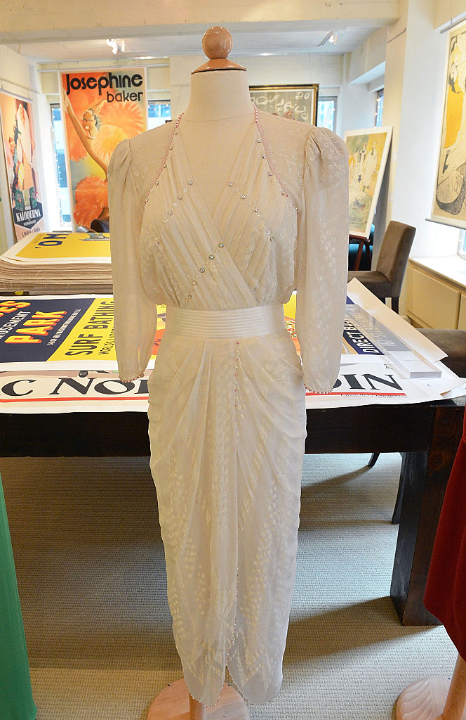 A Zandra Rhodes ivory silk chiffon gown embellished with simulated pearls and deep pink faceted glass
