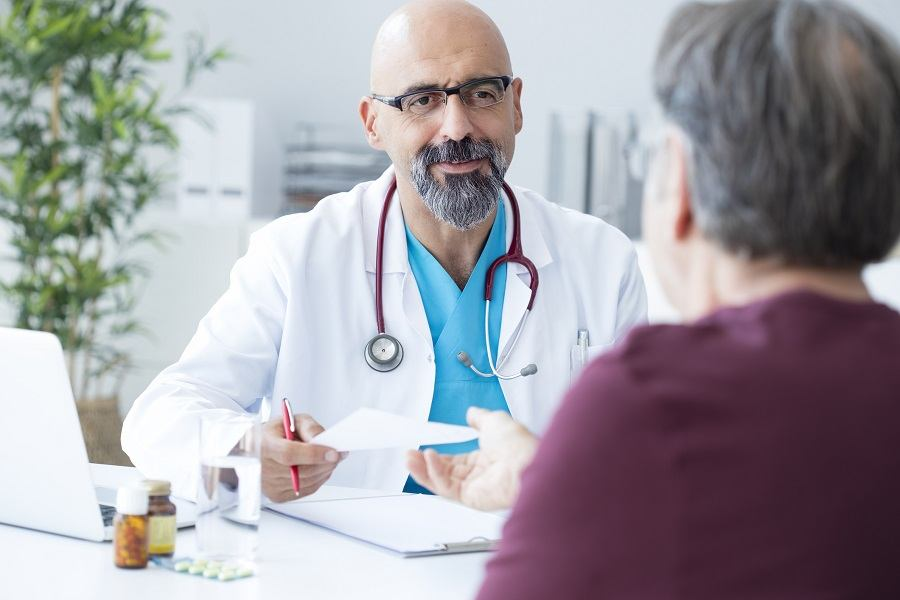 Male doctor talking to patient