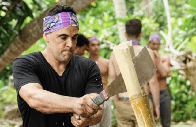 Domenick Abbate chopping up a bamboo plant.