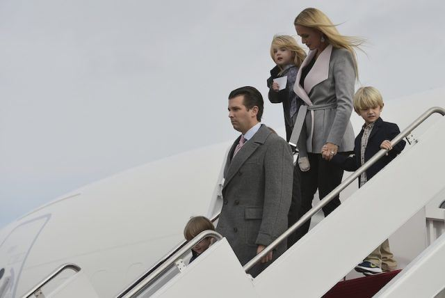 Donald Trump Jr. walking out of an airplane with his wife and children.