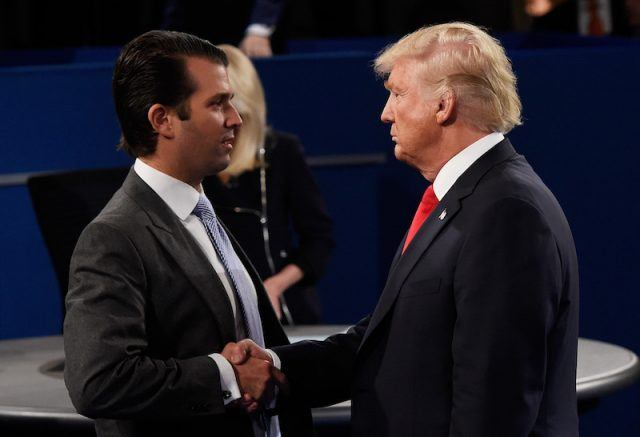 Donald Trump Jr. shaking Donald Trump's hand.