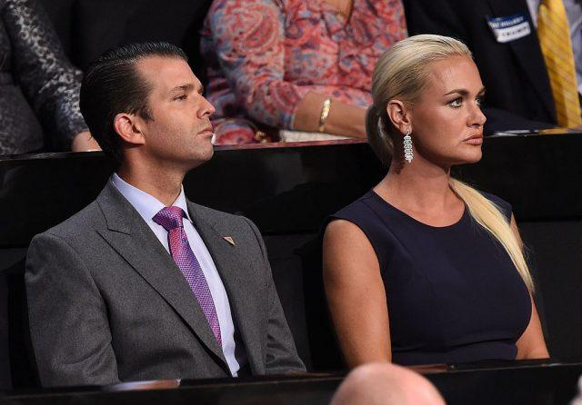 Donald Trump Jr. and Vanessa Trump sitting next to each other.