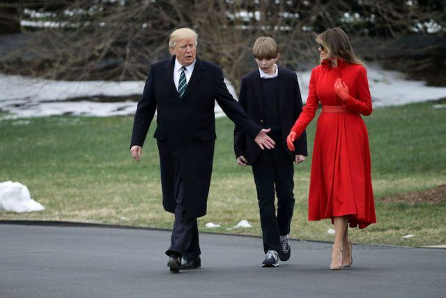 Donald Trump walking with Barron and Melania Trump.