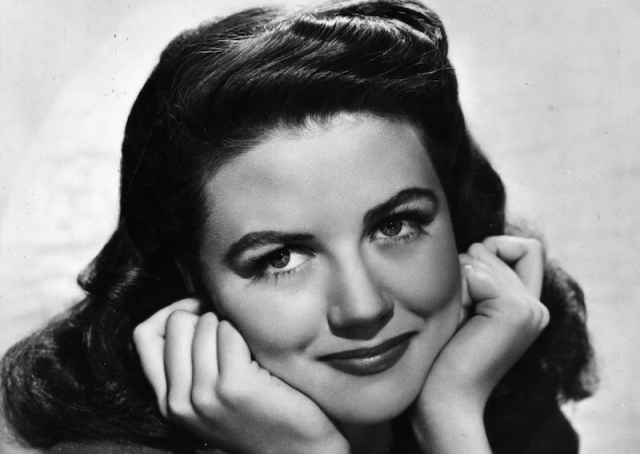 Dorothy Malone in a black and white photograph.