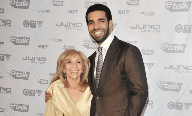 Drake and his mother smiling on a red carpet.