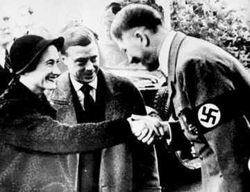 Wallis Simpson being greeted by Adolf Hitler.