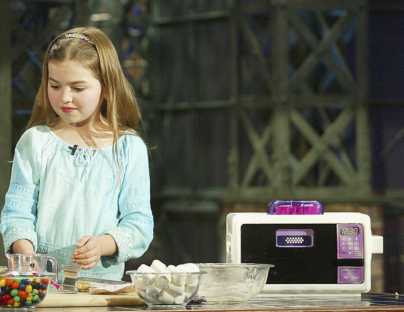 Girl with easy bake oven