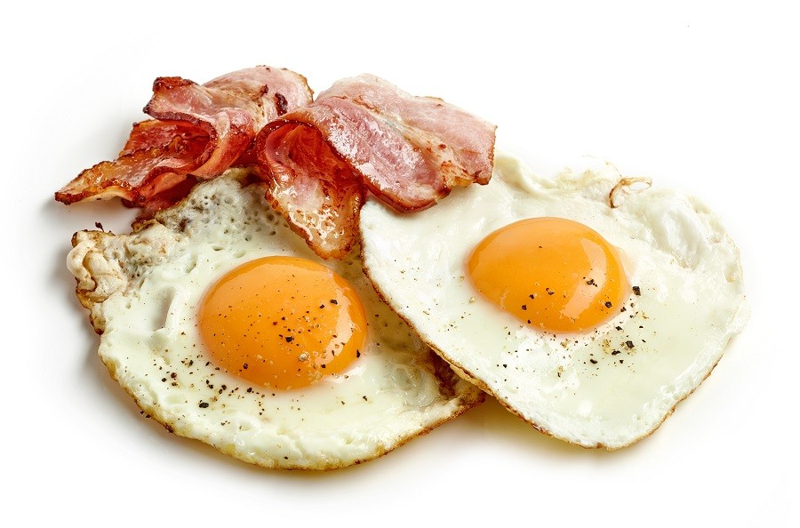 fried eggs and bacon slices