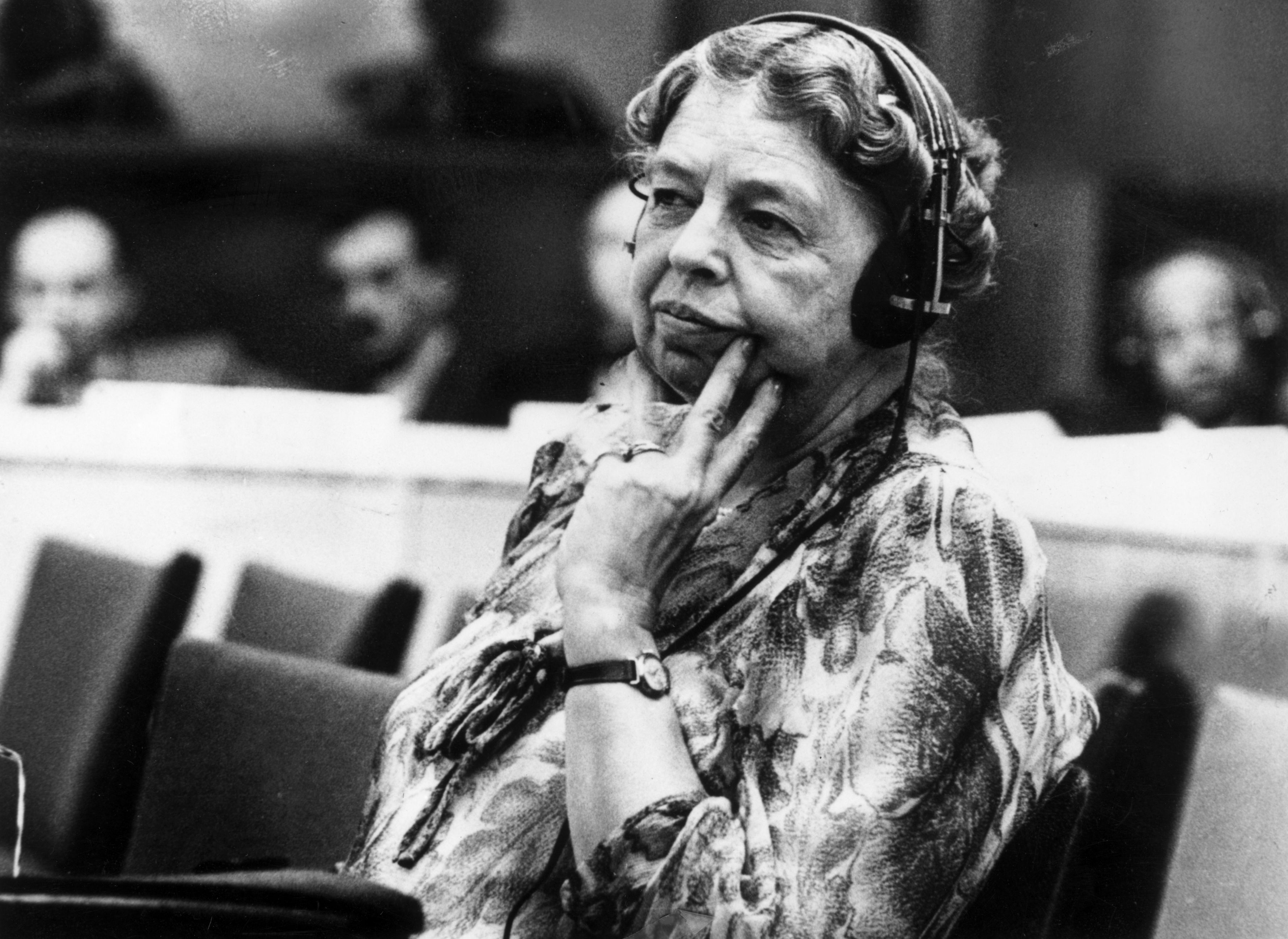 Eleanor Roosevelt listening through headphones at UN conference