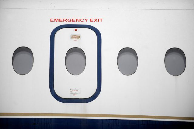 An emergency exit on a plane.